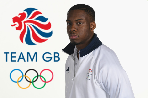 BIRMINGHAM, ENGLAND - JULY 09: (EDITORS NOTE: This image has been digitally altered - LOGO ADDED TO BACKGROUND)  Lutalo Muhammad (Taekwondo) poses for a portrait during Team GB kitting out ahead of Rio 2016 Olympic Games on June 26, 2016 in Birmingham, England.  (Photo by Gareth Copley/Getty Images)